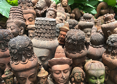 Image of various Buddha heads piled in a mound