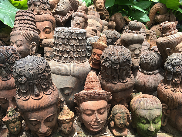 Pile of stone Buddha heads